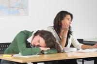 Bored teenage girls in class